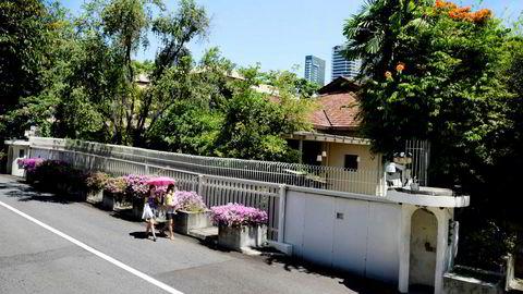 En 110 år gammel falleferdig rønne i Singapore sentrum, hvor landsfader Lee Kuan Yew bodde, har skapt en familiefeide hos landets mektigste familie - og sjokkert Singapore.