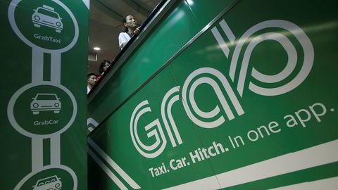 Kjøretjenesten Grab overtar Ubers virksomhet i Sørøst-Asia.