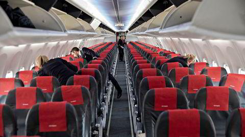 En passasjer får refusjon fra Norwegian etter å ha betalt dyrt for flysete gjennom en prisauksjon.