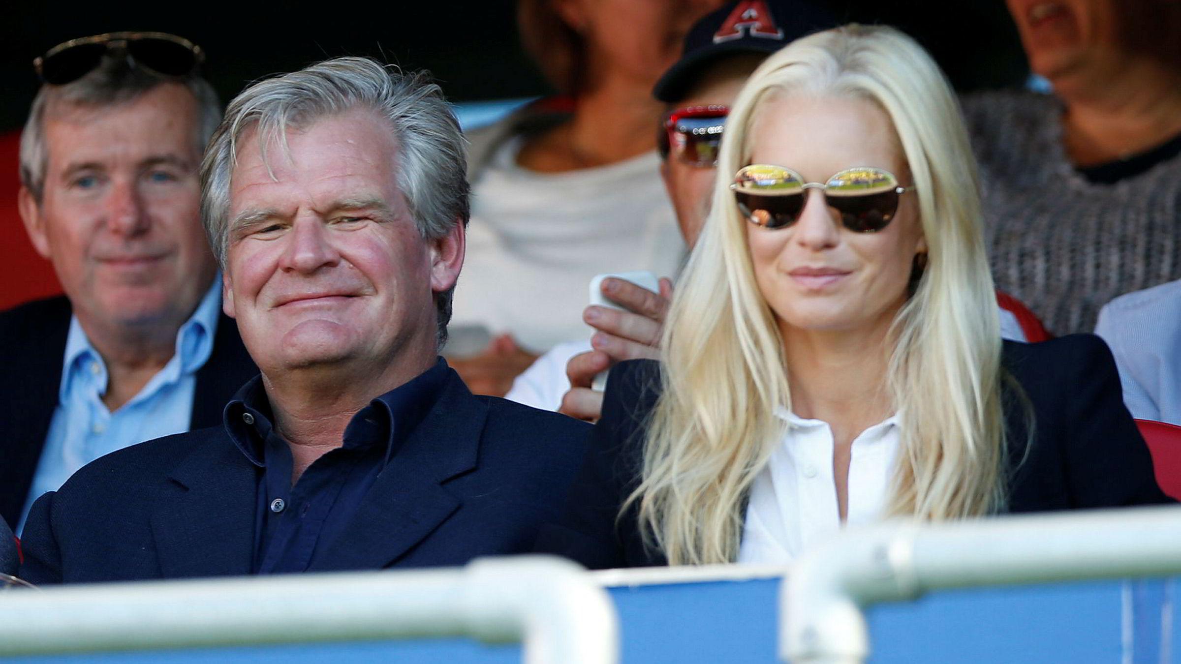 Tor Olav Trøim sammen med sine kone Celina Midelfart på en Vålerenga-kamp.