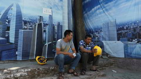 Kina protesterer mot Moody's nedgradering av landets kredittrating. Ratingbyrået er bekymret for gjeldsveksten i Kina, som blant annet går det enorme utbygginger som her i Beijing.