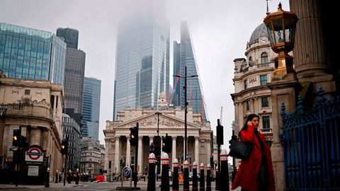 A pedestrian walks near the Royal Exchange and the Bank of England in the City of London on the bank holiday, December 28, 2020, as Londoners continue to live under Tier 4 lockdown restrictions. - Business breathed a sigh of relief this week after a post-Brexit trade deal was agreed, but many issues remain unresolved, notably the place of financial services, which represent 80 per cent of the British economy, as the newly inked deal focuses on trade in goods. (Photo by Tolga Akmen / AFP)