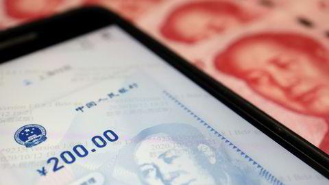 Kina er i gang med uttesting av digitale penger som det første større land i verden. 100.000 brukere vil få gratis penger denne uken for å handle i fysiske butikker.