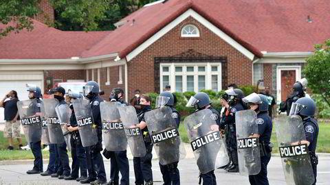 Amerikanske politistyrker i aksjon mot demonstranter 10. juli i år, Detroit.