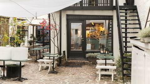 Nyoppussede Kolonihagen Frogner deler en hyggelig, frodig bakgård med en blomsterbutikk