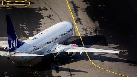 SAS vil neste år bare satse med nye fly i to datterselskaper som foreløpig har fått navnet «SAS Midsize» og SAS Ireland. Mannskapet skal være billigere og ha mer fleksibel arbeidstid enn i morselskapet. Her fra Oslo lufthavn.