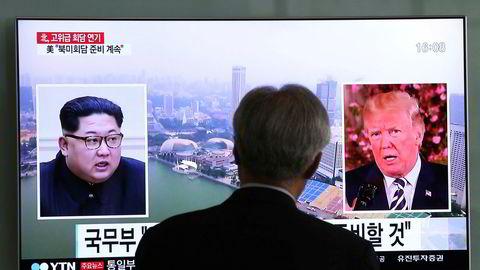 USAs president Donald Trump og Nord-Koreas leder Kim Jong-un, her sett på en TV-skjerm i Sør-Korea.