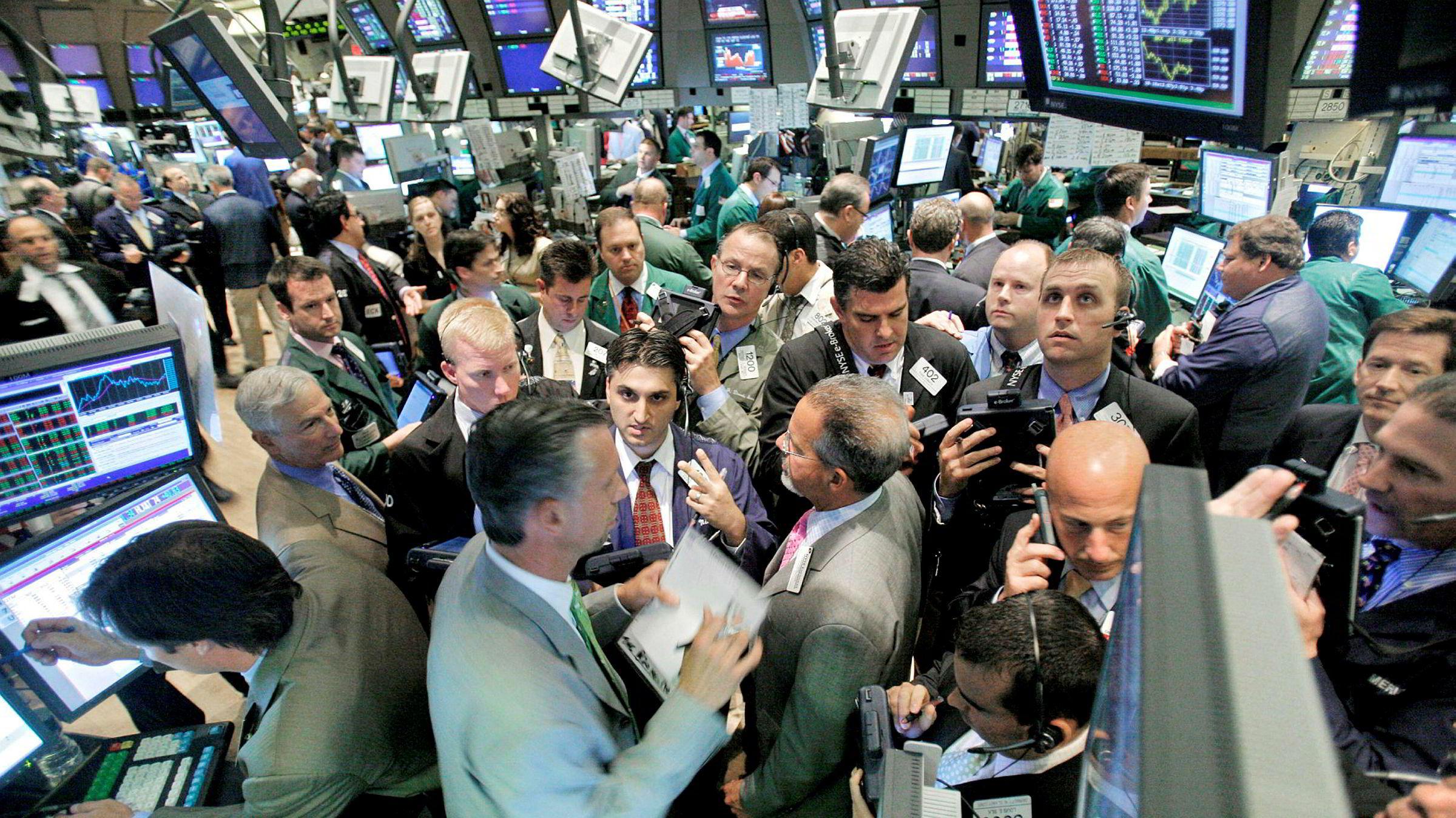 Ti år vist seg å være et ganske bra anslag på tidslengde mellom krisene. Vi hadde kriser i 1987, 1998 og 2008 (på 70-tallet var det kriser hele tiden). Bildet er fra New York-børsen fredag 27. juni 2008.